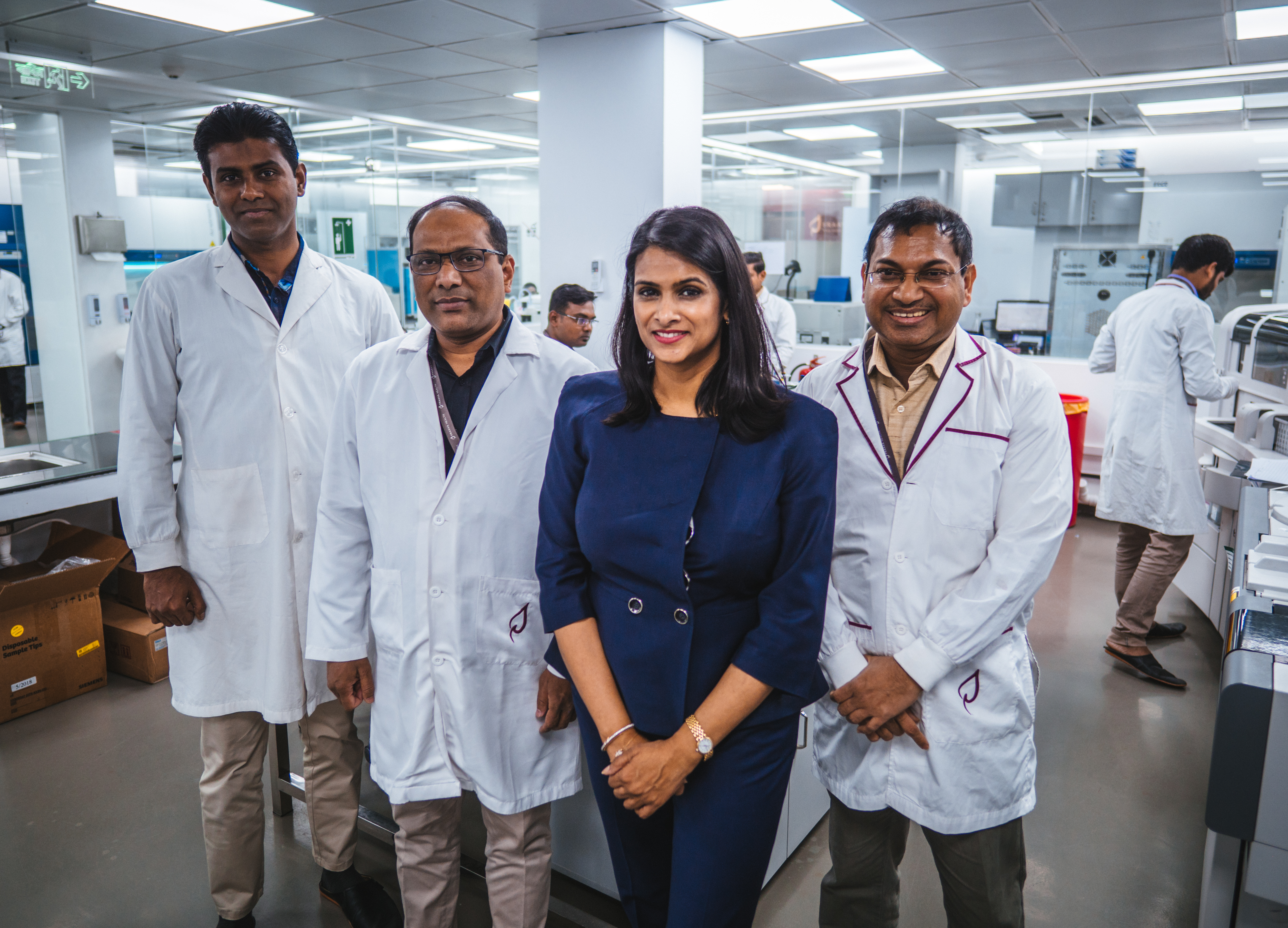 Praava Health founder and chief executive officer Sylvana Sinha (third from left) at one of the company's healthcare centers