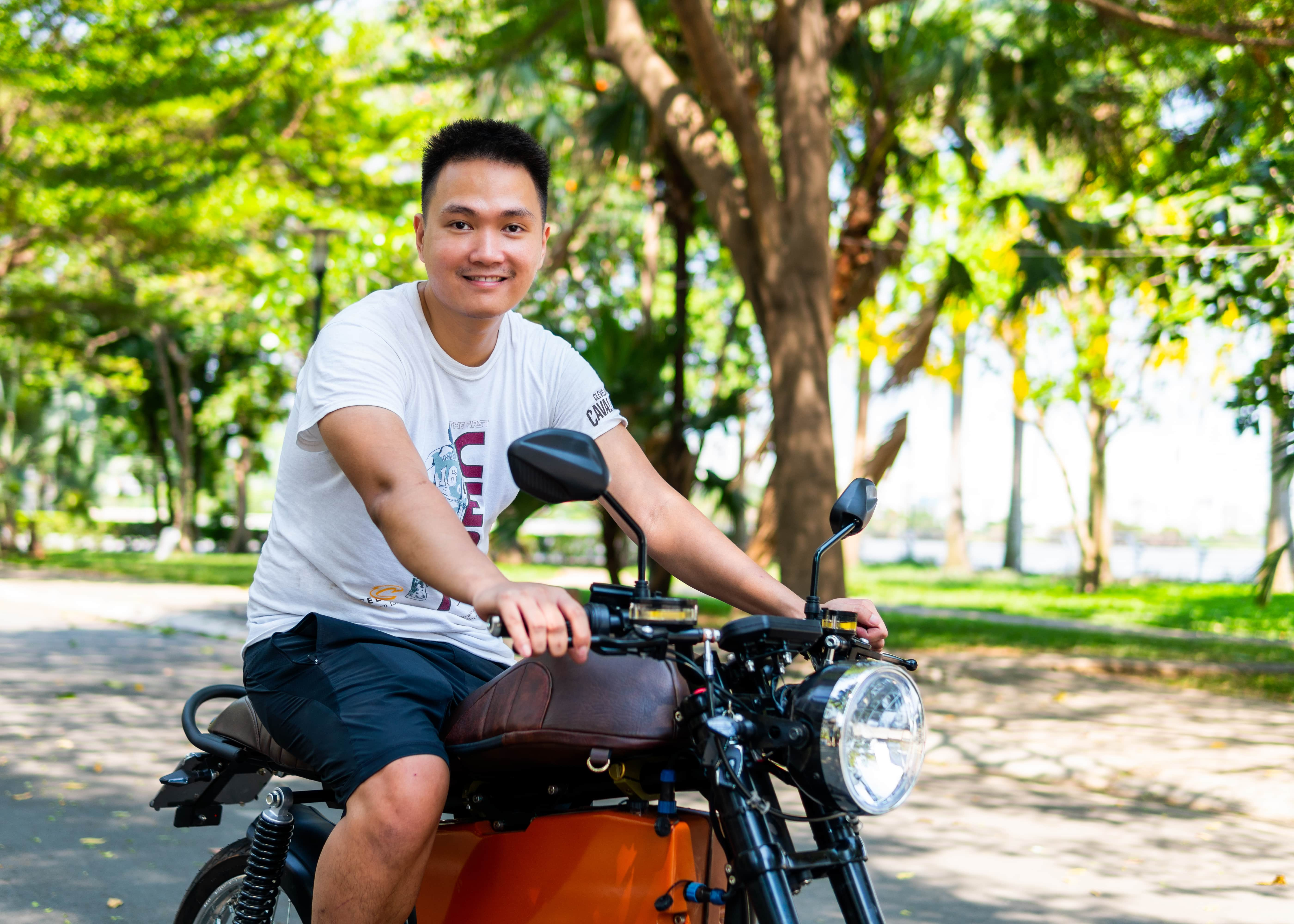 Son Nguyen, founder and ceo of Dat Bike on a of the startup's motorbikes