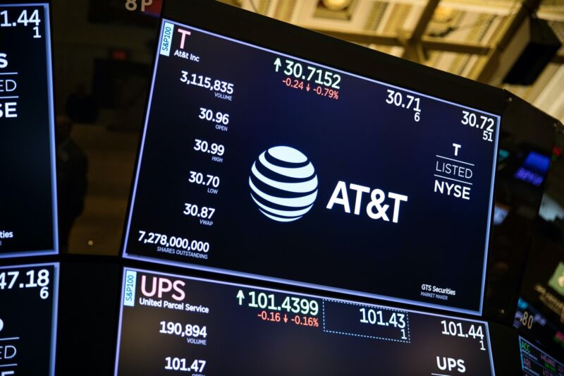 AT&T's logo and stock price displayed on a monitor on the floor of the New York Stock Exchange in January 2019.