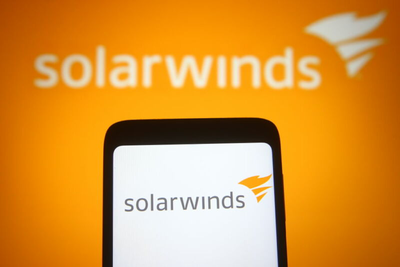 A phone and the wall behind it share a solarwinds logo.
